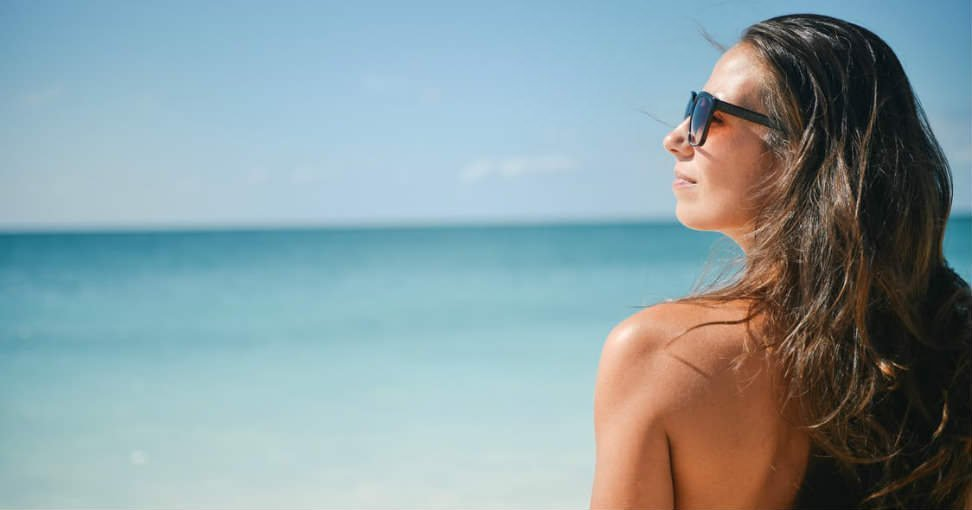 Zonbescherming: zo verzorg je huid en haar
